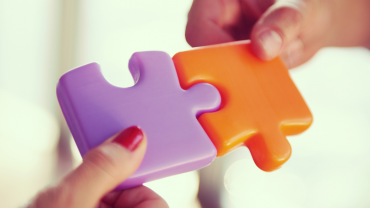 2 hands with puzzle pieces