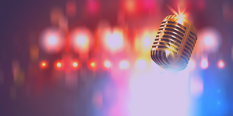 microphone with colorful lights in background